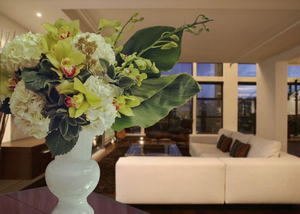 Residential floral design: Succulent blooms, white hydrangea, green dendrobium, calla lily leaves, green cymbidium orchids.