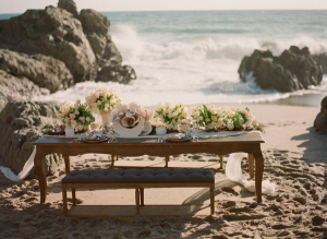 Table setting with muted floral bouquets for a beach wedding in Malibu California.
