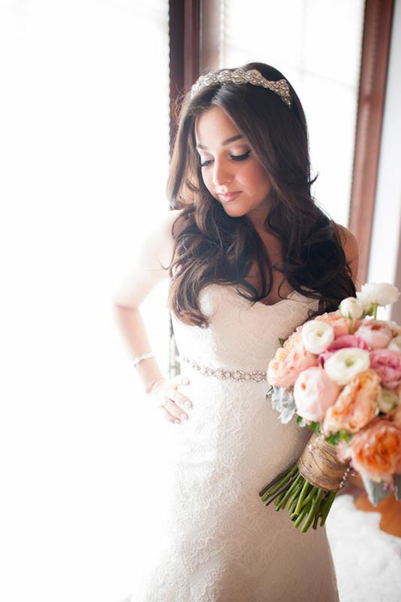Celebrity Alisan Porter in her wedding dress holding a bridal bouquet by La Petite Gardenia.