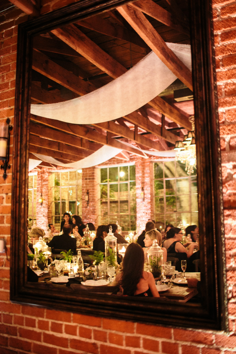 Wedding reception at Carondelet House captured in a mirror.