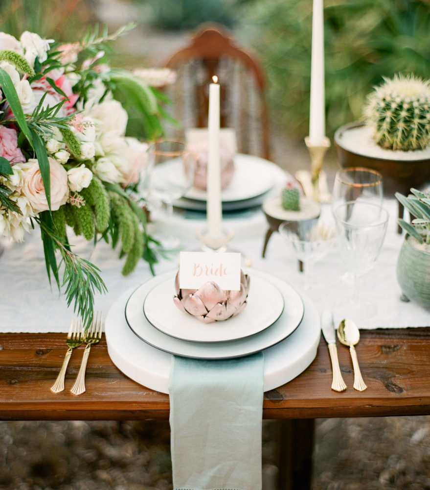 Photo of artichoke wedding table plate setting.