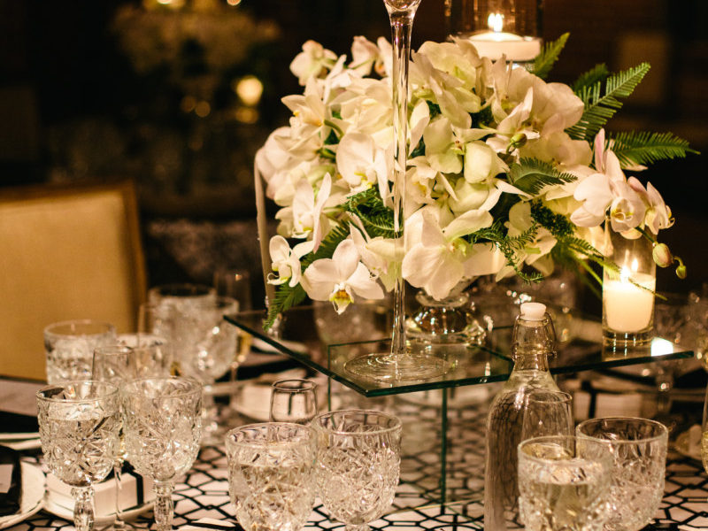 Close up of wedding table set up and centerpiece with white flowers at Carondelet House.