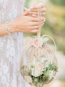 Close up of a romantic caged succulent bridal bouquet.
