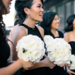 Close up of bridal party holding white wedding bouquets.