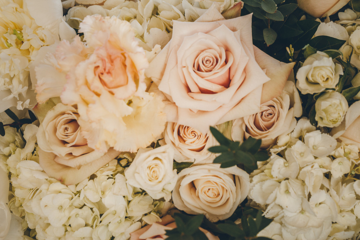 Close up of blush, cream and peach wedding flowers.