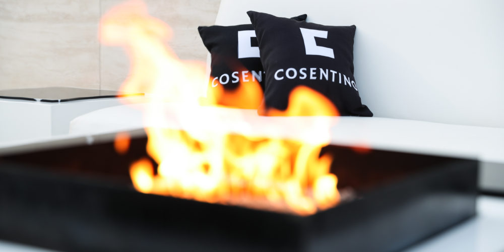 A fire pit in front of a white couch at a Hollywood event.