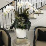 Close up of a Halloween orchid arrangement by La Petite Gardenia in the entryway of a Beverly Hills home.