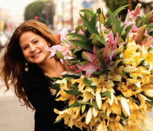 Alison Franchi with a bouquet of fresh flowers