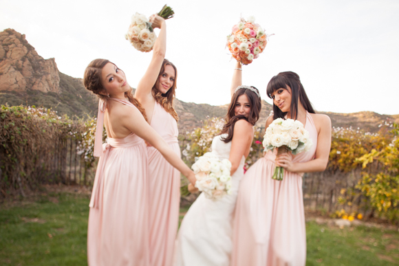 Alisan Porter and her bridal party pose in the mountains with bridal bouquets by La Petite Gardenia.